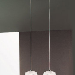 """Vistosi - Vistosi Damasco SP 2 C Pendant Light - Product Description: The Damasco double pendant by Vistosi is designed by Paolo Crepax 2003. The light is created using """"Bozzolo"""" technique, which entails manually applying threads of moulded glass in a pre-shaped element in blown crystal. This beautiful pendant has been handmade on the Venetian island of Murano. Every light comes with a certificate of authenticity.  Product Description:  The Damasco pendant by Vistosi is designed by Paolo Crepax 2003. The light is created using """"Bozzolo"""" technique, which entails manually applying threads of moulded glass in a pre-shaped element in blown crystal. This beautiful pendant has been handmade on the Venetian island of Murano. Every light comes with a certificate of authenticity.                         Manufacturer:             Vistosi                            Designer:                         Paolo Crepax 2003                                         Made in:            Italy                            Dimensions:                         width: 4.7"""" ( 12 cm ) overall width: 10.8"""" (27.5 cm)              height: 3"""" ( 7.5 cm ) overall height: 55.1"""" (140 cm)                                         Light bulb:                         2 x 75W G9 halogen                                         Material                         glass, metal"""