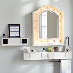 Hannah Beauty Mirror + Shelves - These supersmart bath accessories maximize space so you can get ready and stay organized. The Cubby Shelf features cutouts for holding style supplies, and the Hair Accessories Organizer features multiple cubbies and an iron bar below for hanging towels or washcloths. Designed with a theatrical flair, the mirror features graceful arches and over a dozen spherical glass bulbs to shine a new light on your get-ready routine.