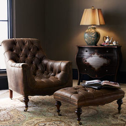 "Old Hickory Tannery - Old Hickory Tannery Tufted Ottoman - Exclusively ours. Tufted leather chair and ottoman have a maple frame with dark-cherry finished legs and casters. Made in the USA. Chair, 33""W x 45""D x 37.5""T. Ottoman, 33""W x 21""D x 14""T."