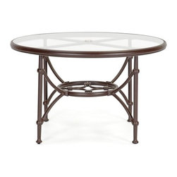 Caluco Origin 48 in. Round Dining Table - Take your next dinner party outside to the Caluco Origin 48 in. Round Dining Table. With seating for four, the dining table is built to withstand the great outdoors with its fully welded, rust-resistant extruded and cast aluminum frame. Like each item in the Origin collection, this table creates a mood of timeless relaxation. It also features a powder-coat finish in a rich espresso tone, providing attractive style and maximum UV protection. It boasts a tempered-glass top and an attractive lower shelf design as well. This table is shade-ready with an umbrella hole. Nylon glides help the lounge move easily without damaging your deck or patio. Includes a 10-year limited warranty. Dimensions: 48 diam. x 29H inches.About CalucoCaluco Patio Furniture is a direct importer of high-end outdoor patio furniture. They specialize in providing Grade A aluminum, teak and wicker furniture, expertly manufactured, and sold to you at affordable prices. Their outdoor patio furniture is shipped directly to their 40,000 square foot facility in San Fernando, California; and from their facility, they ship it directly to you. Their clients choose them for their expertise and their ability to combine high end quality with customer care, without the high-end pricing.