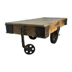 """Pre-owned Industrial Reclaimed Wood Cart Table - An Industrial Modern reclaimed wood and iron rolling cart, that's been turned into a cool coffee table. This solid and sturdy piece sits atop casters and is in excellent vintage condition.    Measures:  51.5"""" L x 25.5"""" W x 18"""" H"""