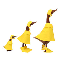 Teak Puddle Ducks - You won't be able to resist the whimsy of this hand-carved family of teak ducks, all kitted out for puddle jumping in their bright yellow rain attire. Whether you place them in your foyer, kitchen or sunroom, they're sure to elicit chuckles from all.
