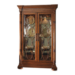 Tommy Bahama Home - Tommy Bahama Home Island Estate Mariana Curio Cabinet in Plantation - Tommy Bahama Home - Curio Cabinets - 010531864 - The Island Estate Mariana Curio Cabinet is constructed from Maple veneers and select hardwood solids in a lightly distressed warm umber tone Plantation finish. It features a mirrored back for a sense of depth lighted interiors to illuminate your collection six glass shelves and two glass doors with decorative bamboo fretwork. Display your collections with the luxurious Island Estate Mariana Curio Cabinet.Inspired by tropical design elements the Island Estate Collection by Tommy Bahama Home has a unique combination of natural materials textures and rich new finishes. Lightly distressed warm umber tones with custom designed hardware in an antique brass finish accentuate the British Plantation and refined Caribbean styling. Designed for an elegant yet casual and cool lifestyle the Tommy Bahama Home Island Estate Collection offers the appeal of an exotic island environment.Features: