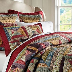 Bandana Patchwork Quilt, Full/Queen, Multicolor - Pure cotton sheeting squares soften the look of our handmade, traditional bandana quilt. Such quilts are long noted for their use as not only bed coverings but as luxe tablecloths and picnic blankets. Crafted of pure cotton. Pure cotton batting. Hand quilted. Quilt and sham reverse to solid red. Sham has an envelope closure. Quilt, sham and insert sold separately. Machine wash. Imported.