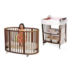 "Stokke - Sleepi Crib Set in Walnut with Mattress - The Stokke Sleepi Crib Set is stylish and functional. As your child develops and grows, you can change and adjust the mattress height positions to grow along with them. Not only is this a crib but it can also be converted into a toddler bed or two chairs as your baby gets older. The Stokke Care Changing Table is also height adjustable with two different working levels to fit any size user. Choose from a number of other optional bedroom furniture pieces from this set, like the popular Tripp Trapp High Chair, or the Keep Storage Unit.  Features: -Beautiful Walnut finish -Made of Beechwood -Crib includes one mattress and converts to toddler bed or two chairs (no additional hardware required), includes lockable wheels and has 4 different mattress positions -Machine washable mattresses are made of high-quality, hypo-allergenic foam with a netting underside -7-year guarantee on all wooden components -Changing Table includes white changing pad, 2 white storage containers, two metal rails and a bumper -Optional Care Changing Table Student Desk Expansion Kit can convert the Care Changing Table into a small desk -Optional Storage Pocket made for use with the Sleepi Bassinet, Crib, Junior Bed and the Care Changing Table -Optional Keep Storage Unit Complete includes 2 basepacks, 2 wallpacks, 1 doorpack and 2 shelfpacks; can be set up 11.8 or 33.6 inches deep -Optional Sleepi Canopy Rod attaches to the crib; seat cushion and baby rail sold seperately -Optional Sleepi Junior Bed Conversion Kit converts your child's Sleepi Crib into the Sleepi Junior Bed and includes 1 mattress -Optional Drawer Box fits perfectly underneath the Sleepi Junior Bed -Optional Sleepi Crib Waterproof Sheet made of 43% cotton, 7% polyester, 50% pvc Click Here to View Other Stokke Items Specifications: -Crib Dimensions: 33"" H x 50"" W x 29"" D Click Here for Product Registration This Crib is approved for use in the United States. This is a NON-Drop Side crib"