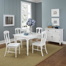 HomeStyles - Brushed White 5 Piece Dining Set - Includes table and 4 chairs. Inspired by the fusion of British colonial and old world tropical design, the Bermuda 5PC Dining Set highlights hardwood solids and engineered wood in a designer visible brushed stroke white finish. Further inspiration can be found in the intricate, detailed turned legs. Perfect for any dining area large or small, the table extends to 66 inches wide with 18 inch removable leaf. Chairs feature intricate details and contoured seats. Chairs are packed two per carton. Set includes rectangular table and four chairs. Dining Table size: 48 in. W x 36 in. D x 30.5 in. H. Chair size: Each: 18 in. W x 21.75 in. D x 39 in. H