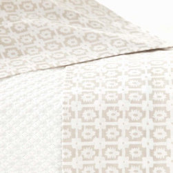 Esha Platinum Sheet Set - Striking silvery neutrals lend polish and class to the small-scale traditional block print which gives the Esha Platinum Sheet Set its rhythmic, graphic effect.  A more dynamic alternative to solid sheets which maintains the comfort and practicality of light colors, this luxury 200-thread-count cotton sheet set adds a new dimension of pattern to your transitional bedroom's layers of fabrics.