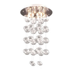 Vector Ceiling Lamp - Harmonious orbs hang from a polished stainless steel base. Ten 15W halogen lights create the warm glow of the Vector ceiling lamp. The lamp is UL approved. Glass, Stainless Steel. G4 Halogen Type T 10x max. 15W. UL Listed, bulb included.