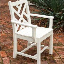 POLYWOOD - POLYWOOD Chippendale Recycled Plastic Dining Arm Chair - CDD200BL - Shop for Chairs and Sofas from Hayneedle.com! Available in a variety of colors so you can easily match your outdoor decor the Polywood Chippendale Recycled Plastic Dining Arm Chair is easy to maintain with soap and water. Crafted from recycled plastic which won't rot or fade the stainless steel hardware helps to ensure the durability of this chair. Additional Features Made in the USA Won't warp crack splinter or support bacterial growth UV stabilized colors keep up the color About Poly-WoodThe advantages of Poly-Wood Recycled Plastic are hard to ignore. Poly-Wood absorbs no moisture and will NOT rot warp crack splinter or support bacterial growth. Poly-Wood is also compounded with permanent UV-stabilized colors which eliminates the need for painting staining waterproofing stripping and resurfacing. This material is impervious to many substances including salt water gasoline paint stains and mineral spirits. In addition every Poly-Wood product comes with stainless steel hardware. Poly-Wood is extremely easy to clean and maintain. Simple soap and water is all you need to get rid of dirt and make your furniture look new again. For extreme cleaning needs you can use a 1/3 bleach and water solution. Most Poly-Wood furnishings are available in a variety of classic colors which allow you to choose your favorite or coordinate with the furniture you already have. This is sure to be a piece that you will be proud to own for a lifetime.