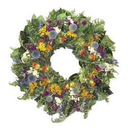 22 in. Meadow Sunrise Wreath - Give your home the look of a wild meadow in summer with the 22 Inch Meadow Sunrise Wreath. Crafted from air dried salal preserved basil salal air dried fern pearly everlasting echinops globe amaranth tansy dark blue larkspur and Safflower this wreath brings bright splashes of color and an artistic flair to your decor.The Flower DepotThe Flower Depot was founded in Tonganoxie Kansas in 1989 in a Depot that was originally built in 1868 by a Carpenter and his Apprentice. The Flower Depot started by growing drying and selling flowers that grew well in the area and slowly expanded. By 2000 The Flower Depot had bought a warehouse and had expanded into gardening bird feeding pest control and environmental products. With their constantly changing product line you'll always be able to find a wide selection of dried and preserved florals silks and pre-made wreaths along with a large assortment of gardening products and tools.
