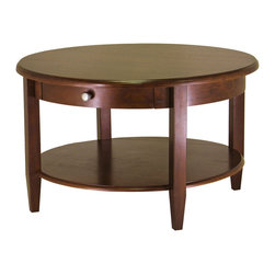 Winsomewood - Concord Round Coffee Table with Drawer and Shelf - Round out your living spaces with this stylish, two-tiered round table and drawer. Designed for fashion and function, this contemporary coffee table has a glossy walnut finish and stylish tapered legs. A bottom shelf becomes a handy home for everything from magazines to tonight's movie selection.