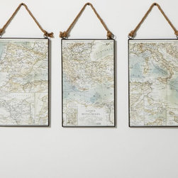 Map Triptych - This map triptych from Pottery Barn is the perfect piece for the world traveler. The art is divided into three sections and can be hung close together or with space between to fill a larger wall. The copper frames and ropes give an industrial feel, while the vintage maps leave us daydreaming of a far-off adventure.