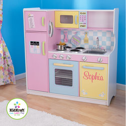KidKraft - Personalized Pastel Play Kitchen Set - Give your little kitchen helpers a new kitchen of their own with the Pastel Play Kitchen Set. This updated model features a solid white counter top, plastic stove burners and metal sink faucet to replicate real kitchen fun! With tons of storage and creative features, your chefs will never get bored! Features: -Constructed of wood and wood products -Functional refrigerator doors -Knobs on the sink and oven that turn -Metal sink faucet -4 metal stove burners -Large white countertop -Transparent doors on the microwave and oven -Frescoed water and ice dispensers on refrigerator -Includes clock, phone with caller ID and notepad on side of fridge -Several shelves for storage -Limit 10 characters- letters A-Z only.