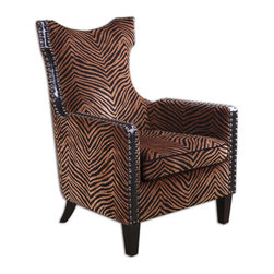 Uttermost - Kimoni Wing Back Armchair - Animal magnetism! From a golden brown fabric that's rippling with zebra stripes to a double row of nailheads ending in ebony legs, this high-back wing armchair tells an exotic story. But, you don't need a safari guide to tell you that this is the ultimate accent chair for your uptown digs.
