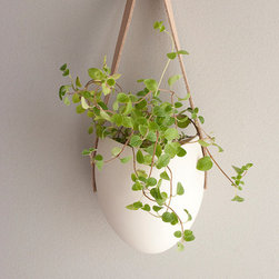 Porcelain and Tan Leather Hanging Planter by Farrah Sit - This is the perfect place to grow herbs or to add just a little greenery to the kitchen.