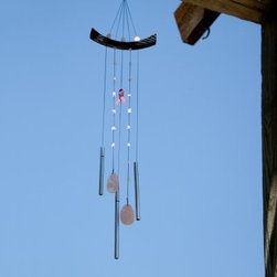 Woodstock 30 Inch Chimes of Hope Wind Chime - Give a gift of hope to a special woman with this beautiful chime dedicated to the fight against breast cancer. The Woodstock 30-Inch Chimes of Hope Wind Chime features the familiar symbol of hope for breast cancer patients and survivors: the pink ribbon. The suspended pink ribbon on this wind chime is made of powder-coated steel and the beautiful accents on the strings are genuine stone. The three silver aluminum tubes hanging below are precision-tuned to create pure vibrations of comforting sounds. The curved top hanger is made of durable ash wood and finished in a striking black color. A portion of the profits from this wind chime will be donated to organizations committed to the fight against breast cancer. The chime and the donation make a meaningful gift for any woman who is battling breast cancer. The visual beauty and soothing tones of the chime will inspire hope in the midst of challenge. Woodstock Percussion Wind Chimes are tuned using a computerized tuning process in order to achieve incomparably beautiful sound. These wind chimes also use a unique tuning system known as just intonation. The frequencies at which the different tubes vibrate are integrally related thus producing the purest musical intervals. Once you hear the beautiful tones created by these magical chimes you will understand why they are so popular around the world. Wind Chime Length: The length of a wind chime is measured by the overall length of the chime (not tube length)- hanging hook to the end of the sail. This windchime is 30 inches long overall. About Woodstock ChimesCreated by professional musician Garry Kvistad Woodstock Chimes feature original and innovative designs that will add beauty and elegance to your home. Each chime has been tuned to create the purest most beautiful musical intervals. Kvistad incorporates tunings of scales from many different cultures throughout the world to create unique inspiring sounds and styles. It's easy to find the chime that's right for you at Woodstock home of the original precision-tuned wind chime.