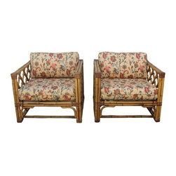 """Pre-owned Vintage Rattan Chairs Philippines Import - A Pair - A pair of vintage rattan chairs imported from the the Philippines. This chairs feature solid, tough rattan stems with almost 2"""" diameter! Rattan furniture is much stronger than bamboo, which is hollow.     The chairs feature newly upholstered custom made fitted loose cushions with piping. All cushions and pillow have zippers, easy to remove and wash. The lining under the cushions has recently been replaced. The chairs have their original yellow-gold finish, which could use a new clear coat. They have gorgeous diamond-detailed fretwork all around, including the backs! All of the leather binding is present and without tears.     The chairs come from a pet-free and smoke-free environment. They were kept under a fully covered patio and protected with individual covers off-season. The chairs have had only one owner and are ready for a new home or makeover!    This chairs are part of a hard to find full set! Each piece is listed separately. Please see seller's other listings. Other items listed: a sofa, a coffee table and side tables."""