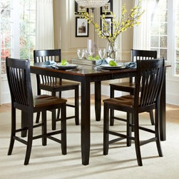 AHB Ellington 5-Piece Counter Height Dining Table Set - A beautiful gathering place for you and your guests to visit or enjoy the view from your favorite window, the AHB Ellington 5-Piece Counter Height Dining Table Set lends a touch of traditional style to your home. Finished in a two-tone Navajo and black over select hardwood solids, this table comes with four counter height chairs, and features a butterfly leaf to give you and your guests a little extra elbow room.American Heritage BilliardsBefore founding American Heritage Billiards back in 1987, the owners were building pool tables in high school, learning the industry from the ground up. Today their 170,000 sq.-ft.-facility, centrally located in Cleveland, Ohio, is the largest billiards manufacturer in the world, the leader in design, selection, service and value. Each item of entertainment furniture is meticulously designed and engineered to withstand the test of time, utilizing old-fashioned wood joinery methods. The vast majority of our metal products have welded joints to provide a lifetime of carefree service.
