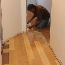 Residential remodel - Redondo Beach - Hallway - during (gluing down prefinished engineered maple on cork)