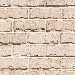 Triangle Brick's Cape Fear - Our Cape Fear brick features a soft beige color reminiscent of the North Carolina coast's pale, sandy beaches. Scattered subtle brown accents throughout add texture and depth to this washed tumble brick, offered exclusively in our Select tier. The Cape Fear brick, a favorite among our customers, provides a level of quality and consistency unmatched by our competitors.