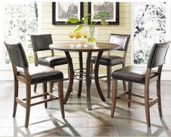 Hillsdale Cameron 5 Piece Counter Height Round Wood Dining Table Set with Parson - Comfortable and stylish the Hillsdale Cameron 5 pc. Counter Height Round Wood Dining Table Set with Parson Chairs is the perfect spot for window-gazing over your morning coffee. This counter-height table comes with four counter chairs each upholstered in dark brown faux leather with decorative nail head trim. Gracefully curved legs and a dark gray metal ring accent complete this counter-height table's beautiful look. About Hillsdale FurnitureLocated in Louisville Ky. Hillsdale Furniture is a leader in top-quality affordable bedroom furniture. Since 1994 Hillsdale has combined the talents of nationally recognized designers and globally accredited factories to bring you furniture styling and design from around the globe. Hillsdale combines the best in finishes materials and designs to bring both beauty and value with every piece. The combination of top-quality metal wood stone and leather has given Hillsdale the reputation for leading-edge styling and concepts.