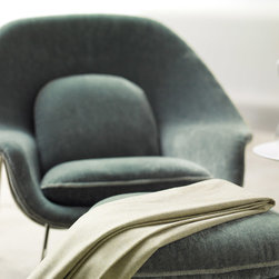 "Saarinen Womb Chair - Eero Saarinen designed the groundbreaking Womb Chair at Florence Knoll's request for ""a chair that was like a basket full of pillows, something I could really curl up in."""