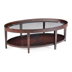 Magnussen T1632 Carson Wood Oval Coffee Table - The Magnussen T1632 Carson Wood Oval Coffee Table is a handsome table that's sure to become the center of attention in your living room. Made from sturdy hardwood solids and select cherry veneers, this modern-style piece is treated with a rich sienna finish that helps emphasize its soft curves. A beveled clear-glass insert in the tabletop provides a delightful play of light on the lower display shelf. This beautiful coffee table makes a handsome pair to any traditional or modern style piece.About Magnussen FurnitureFrom its beginning as a small furniture company in Ontario, Canada, Magnussen Furniture has evolved into a full-line furniture resource with offices in Canada, the United States, and the Far East. Their business is creating furniture designs of exceptional style, value, and beauty. They produce these designs in partnership with manufacturing partners around the world that meet exacting standards for superior quality at the best possible value.