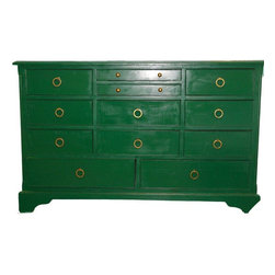 Used Hollywood Regency Style Emerald Chest of Drawers - Green is the color of envy - and also the color of this Hollywood Regency style chest that all of your guests will covet. This over-sized chest of drawers has been fully restored in Kelly green Benjamin Moore paint (loving applied with a sprayer for an even finish), cheetah-print drawer lining and brass hardware. The two top drawers are felt-lined for your fabulous baubles. Lastly, it's been topped with a gray glass piece to protect the fabulous finish.