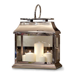 Rectangular Lantern in Nickel - The Rectangular Lantern in Nickel boasts a shimmering lustre and classic form like that of lamps that long ago graced the lanes of London. Fashioned from brass and generously sized to hold more than one candle, the lantern suffuses its surroundings with a soft and glinting glow that is mirrored in the shimmering surface of the piece. A round handle at the top affords ease in carrying.