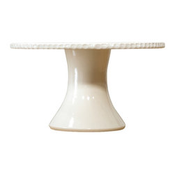 Pigeon Toe Ceramics - Serrated Cake Stand - Finally a cake stand that is space-efficient to store, and provides more than one use! Removing the plate (which sports a hand-cut edging detail) reveals a generously sized minimalist vase ready for a cluster of flowers. Both pieces are glazed clear for easy cleaning. Porcelain; hand thrown.