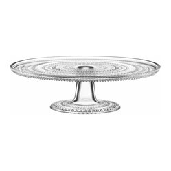 "Iittala - Kastehelmi Cake Stand Clear - Don't merely serve dessert, present it — and get all the ""ooh"" and ""ahh"" reactions you deserve. This charming glass cake plate boasts a dazzling dewdrop pattern on which to display your fresh-baked beauties."