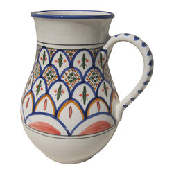 Le Souk Ceramique - Tabarka Large Pitcher - 54 Fluid Ounces. Hand Made . Dishwasher safe . Microwave safe . Made in Tunisia. Lead free glazes . Meets CA Prop 65 . Meets all Federal StandardsNamed in part for the beautiful Tunisian seaside resort town of Tabarka where the red tile roofs of the Mediterranean beach bungalows dot the coastline, our Tabarka pattern is an elaborate blend of Italian, French and Arabic styles that throughout history have also shaped it's namesake city. Shades of fire red, goldenrod, grass green and cobalt blue are set against a white background creating a sumptuous and vibrant pattern perfect for any occasion.