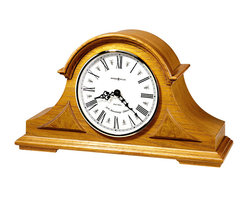 "Howard Miller - Burton Tambour Mantel Clock - From tradition to contemporary, the bridge to quality time telling begins with this selection. A mix of elements like cast metal and fine wood easily translates into a stylish unique addition to any room. In the realm of today, accent your bedside, mantel or room with this. * This tambour mantel clock features decorative top molding and triangular burl overlays. . The off white dial features black Roman numerals, black serpentine hands, a convex glass crystal, and a polished brass tone bezel. . Finished in Golden Oak on select hardwoods and veneers. . Quartz, dual chime movement plays Westminster or Whittington chimes with an hour strike, volume control and automatic nighttime chime shutoff. . H. 10"" (25 cm). W. 17"" (43 cm). D. 5-1/2"" (14 cm)"