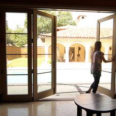 Mediterranean Exterior by Texas Door & Trim, Inc.