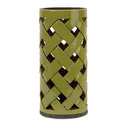 IMAX - Green Large Morelia Cutwork Candle Lantern - 18158 - Shop for Candle Holders from Hayneedle.com! The Green Large Morelia Cutwork Candle Lantern features a handcrafted lattice pattern that creates an alluring glow. It's made of ceramic in a green crackle finish and holds one pillar candle (not included).About IMAXWhat began as a small company importing copper flower containers in 1984 by Al and Faye Bulak has developed into one of the top U.S. import companies serving the At Home market today. IMAX now provides home and garden accessories imported from twelve countries around the world housed in a 500 000 square foot distribution center. Additional sourcing product development and showroom facilities in the USA India and China make IMAX a true global source. They're dedicated to providing products designed to meet your needs. This is achieved through a design and product development team that pushes creativity taste and fashion trends - layering styles periods textures and regions of the world - to create a visually delightful and meaningful environment. At IMAX they believe style integrity and great design can make living easier.