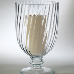 Glamour Hurricane Vase - Fluted glass, clear and made with the slightest twirl to lend gracious panache to its shape, becomes bathed in dancing light when you add your pillar candle.  The Glamour Hurricane Vase is a chalice-shaped holder with an artistic use of texture adding distinction to its clarity.  Use as a large-scale vase or a candleholder for equal grace on the table.
