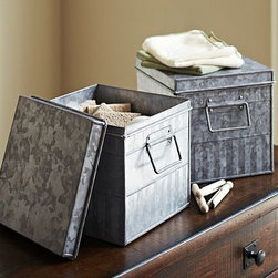 """Galvanized Metal Lidded Handled Bin - Add rugged polish to the laundry, garage or kitchen with galvanized storage. This strong, lidded bin keeps items organized and protected with a rustic character that's reminiscent of vintage industrial designs. 8.25"""" square, 8"""" high Made of galvanized steel. Features a removable lid. Catalog / Internet only."""