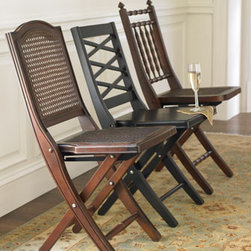 "Wooden Folding Chairs - You'll feel as if you're vacationing and sailing the seas on an grand ocean liner when you sit in one of these wonderful chairs.  These wooden folding chairs are available in the three designs shown here.    * Cane chair, 14.75""W x 20.625""D x 33.375""T.    * Cross-back chair, 15.25""W x 21""D x 32.5""T.    * ""Antigua"" chair, 14.375""W x 20.375""D x 35""T."