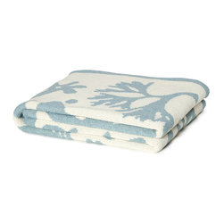 Seascape Throw - Blue Pond - Playfully combining detailed tropical fish and coral motifs in bold silhouette, the overscale design of the Blue Pond Seascape Throw has a refreshing sense of novelty with a nautical appeal.  Made from recycled cotton-blend yarns skillfully knit into a luxurious light blanket, this throw is amply sized and easy to care for, allowing its pleasing pattern to be enjoyed throughout your home.