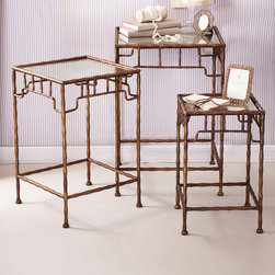 Golden Bamboo Set of 3 Antiqued Mirror Tables - East-meets-West elements drawn from historical golden ages inspired the design of these glamorous nesting Golden Bamboo Mirror Tables.  Antiqued gold finish on the arched spindle aprons and the tall, lean faux bamboo legs of these elegant accent tables brings a gorgeous gravity to the opulent furnishings, while the mirrored tops double the impact of lights or accents placed there.