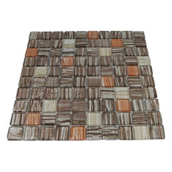 "Terrene Jupiter Blend 1x1 Glass Tiles - TERRENEJUPITER BLEND 1X1 GLASS TILES This striking blend of metallic Brown, Beige and Peach glass can make any room aesthetically appealing. The wavy finish with the 3D background brings a distinctive design and will add a nice touch for a contemporary and modern room. This tile is great to use for the bathroom, kitchen or pool installation. Chip Size: 1x1 Material: Glass Color: Metallic Brown, Beige and Peach Finish: Wavy Sold by the Sheet - each sheet measures 11"" x 11"" (0.84 sq. ft.) Thickness: 3mm - Glass Tiles -"