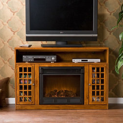 """Southern Enterprises - Southern Enterprises Narita Glazed Pine Media Console with Electric Fireplace Mu - Shop for Fire Places Wood Stoves and Hardware from Hayneedle.com! The handsome Southern Enterprises Narita Glazed Pine Media Console with Electric Fireplace is a versatile media display center cleverly built into a cozy fireplace. Side cabinets include adjustable shelves and the open electronics shelf on top has convenient concealed access holes for cabling to keep your room looking tidy and organized. The stylish glazed pine finish includes distressing and """"worm holes"""" for a natural antiqued look. This easy-to-use fireplace requires no electrician. Just plug it in turn it on and enjoy the cozy atmosphere and LED flames in your home or office. It's energy-efficient too. It heats 1500 cubic feet in only 24 minutes using about the same energy as a coffee maker and produces zero emissions or pollutants. It's safe as well: the glass stays cool to the touch. So kick off your shoes pick up the included remote control and start relaxing in the warm glow. Plus you can enjoy the flames year-round with or without heat.Top shelf dimensions: 46W x 15D x 7H inchesSide cabinet dimensions: 9W x 14D x 21H inches About SEI (Southern Enterprises Inc.)This item is manufactured by Southern Enterprises or SEI. Southern Enterprises is a wholesale furniture accessory import company based in Dallas Texas. Founded in 1976 SEI offers innovative designs exceptional customer service and fast shipping from its main Dallas location. It provides quality products ranging from dinettes to home office and more. SEI is constantly evolving processes to ensure that you receive top-quality furniture with easy-to-follow instruction sheets. SEI stands behind its products and service with utmost confidence."""