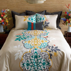 Shangri La Duvet Set - Double décor options, double happiness. The front of our Shangri-La duvet set shows our dramatic, oversized medallion motif printed in turquoise, yellow ochre and storm grey on a white and pebble background. Look closely for a bird, a bee and flowers embroidered in coral. On the reverse, a pattern of white medallions stands like a screen set against storm grey Himalayan slopes. A real karma chameleon.