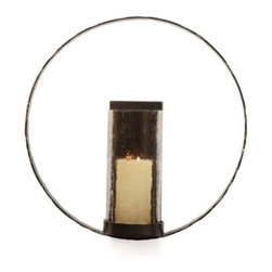 Z Gallerie - Taos Wall Sconce - Clean contemporary living spaces call out for exemplary decorative accessories. Our exclusive Taos Wall Sconce fills that requirement in handsomely designed iron, formed as a minimalist circle enclosing a geometric rectangular backing. A complementary cylindrical shade of hammered luster brown glass protects the flame. Accommodates a standard 3 inch diameter pillar candle (not included).
