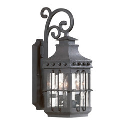 "Troy - Dover Collection 22 3/4"" High Outdoor Wall Light - The Dover outdoor collection from Troy Lighting is crafted from hand-forged iron. A hand-crafted vibe and influence from centuries past shine through in this glorious design. The frame is presented in a natural bronze finish. Panes of clear seeded glass gracefully display the glowing fixtures within. A wonderful design for lighting your outdoor spaces. Hand-forged iron construction. Natural bronze finish. Clear seeded glass. Takes three 60 watt candelabra bulbs (not included). 22 3/4"" high. 8 1/2"" wide. Extends 11 1/2"" from the wall. 11"" from mounting point to top.  Hand-forged iron construction.   Natural bronze finish.   Clear seeded glass.   Takes three 60 watt candelabra bulbs (not included).   22 3/4"" high.   8 1/2"" wide.   Extends 11 1/2"" from the wall.   11"" from mounting point to top."