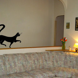 StickONmania - Cat Striding Sticker - A nice vinyl sticker and wall art design for your home  Decorate your home with original vinyl decals made to order in our shop located in the USA. We only use the best equipment and materials to guarantee the everlasting quality of each vinyl sticker. Our original wall art design stickers are easy to apply on most flat surfaces, including slightly textured walls, windows, mirrors, or any smooth surface. Some wall decals may come in multiple pieces due to the size of the design, different sizes of most of our vinyl stickers are available, please message us for a quote. Interior wall decor stickers come with a MATTE finish that is easier to remove from painted surfaces but Exterior stickers for cars,  bathrooms and refrigerators come with a stickier GLOSSY finish that can also be used for exterior purposes. We DO NOT recommend using glossy finish stickers on walls. All of our Vinyl wall decals are removable but not re-positionable, simply peel and stick, no glue or chemicals needed. Our decals always come with instructions and if you order from Houzz we will always add a small thank you gift.