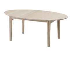 Skovby - Oak Dining Table - All sleek slender legs and smooth oval lines, this dining table is a stunning sight to behold. With solid oak construction and extra leaves neatly stored below the tabletop, you'll find it's as adaptable as it is appealing.