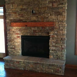 Rustic Oak Cabinetry with Reclaimed Barn Beam Accents - David C Fuhr