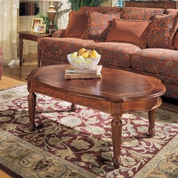 Magnussen 13800 Sedona Wood Oval Coffee Table - The Magnussen 13800 Sedona Wood Oval Coffee Table is the type of piece around which you can base an entire room design. Made from sturdy hardwood solids select veneers, this piece is protected from scratches and spills by an alluring medium-brown cherry finish that enhances the fine details of the wood. Each leg features carved accents and a carved floral relief above. A traditional-style piece itself, this coffee table is a smashing complement to leather furniture or to rooms with natural light.About Magnussen FurnitureFrom its beginning as a small furniture company in Ontario, Canada, Magnussen Furniture has evolved into a full-line furniture resource with offices in Canada, the United States, and the Far East. Their business is creating furniture designs of exceptional style, value, and beauty. They produce these designs in partnership with manufacturing partners around the world that meet exacting standards for superior quality at the best possible value.