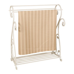 Welcome Home Accents - Whitewash Metal Quilt Rack - Whitewash metal blanket display rack features scrolling and slotted bottom shelf for extra storage space. Three bars for hanging quilts, blankets, clothes, etc.  Sturdy enough for the heaviest of quilts. Assembly required. Dust with a dry cloth.